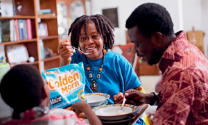 Nigerian family eating Golden Morn affordable fortified cereal